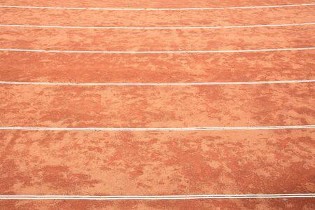 Closeup rough red running track photo
