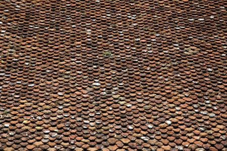 Closeup texture of old red roof tiles photo