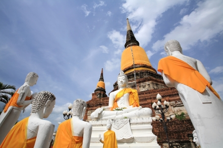 White Buddha statues in front of ancient pagoda against blue sky at Wat Yai Chaimongkol in Ayutthaya, Thailand Stock Photo - 14686240