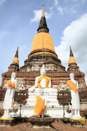 White Buddha statues in front of ancient pagoda at Wat Yai Chaimongkol in Ayutthaya, Thailand Stock Photo - 14804417
