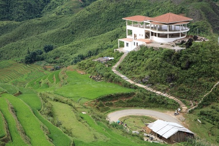 Aerial view of building tower and green terraced rice fields on the mountain at Cat Cat village in Sapa, Vietnam photo