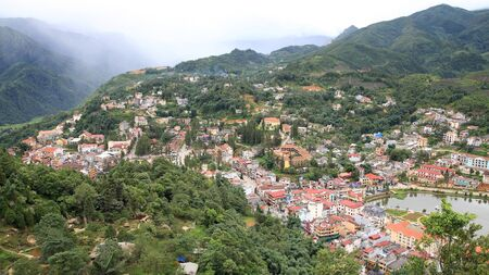 Aerial view of Sapa city nested in green valley in Loa Cai, Vietnam photo