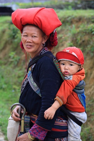SAPA - JUL 23  Unidentified hill tribe mother and her son at the Red Dao Ethnic Minority on July 23, 2012 in Sapa, Vietnam  Red Dao Minority are the 9th largest ethnic group in Vietnam