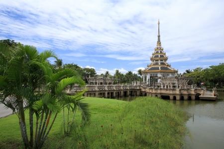 Beautiful pagoda on the pond at Chalerm Prakiat park in Nontaburi province, Thailand