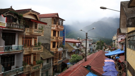 SAPA - JUL 22  old nestled buildings near the mountain with fog on July 22, 2012 in Sapa downtown, Vietnam  Sapa, settled by French colonial on the early 20th century is a frontier town with China