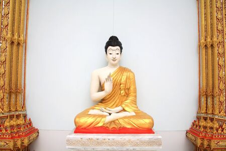 Buddha Image statue with hand sign near the wall and column Stock Photo - 14974995
