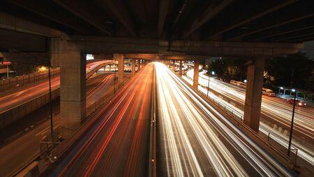 Light trails on the bridge in Bangkok, Thailand