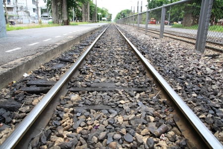Closeup iron railway over dark stone Stock Photo - 15007565