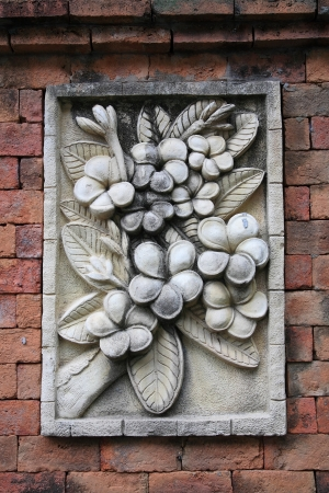 Floral stone carving decoration on brick wall