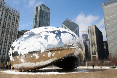CHICAGO,IL-FEB 09  Skygate Bean covering by snow against high building towers and blue sky with unidentified visitors at Millenium Park on February 09, 2008 in Chicago, IL USA
