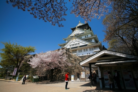 OSAKA-APR 13  Main entrance with cherry blossom against sky at Osaka castle on April 13, 2011 in Osaka, Japan  Here is one of the most famous castles that tourists all over the world want to visit