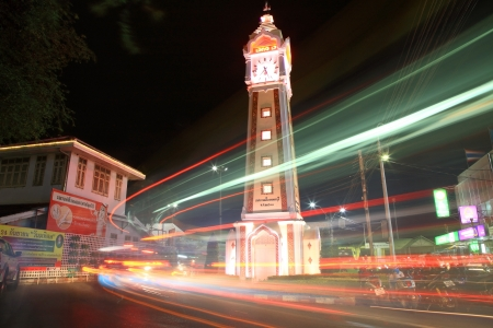 NONTHABURI-SEP 12  Light trails at clock tower on September 12, 2012 in Nonthaburi downtown, Thailand  This clock tower is located near Chao Phraya river pier, Nonthaburi museum, and street market