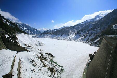 Kurobe alpine dam covering by snow at winter season in Tateyama, Japan photo