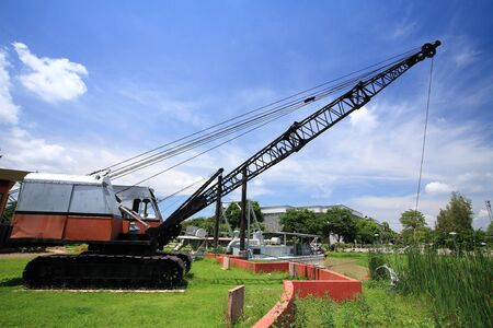 bituminous coal: Old cable excavator on the grass against blue sky
