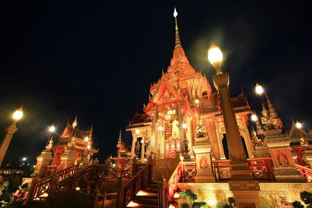 pyre: Bright royal funeral pyre of princess Bejaratana Rajasuda at night on Sanam Luang in Bangkok, Thailand