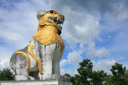 Lion statue in Burma style against blue sky  at Surasri Camp in Kanchanaburi, Thailand  photo