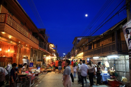 Loei-OCT 27 Unidentified visitors visit Antique wooden town at dusk on October 27, 2012 of Chiang Khan district in Loei, Thailand  Chiang Khan is famous for its simple locality of northeast Thainess