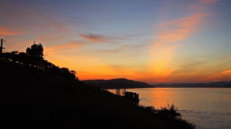 Silhouette scenic at twilight near Mekong River in Chiang Khan, Thailand Stock Photo - 16289758