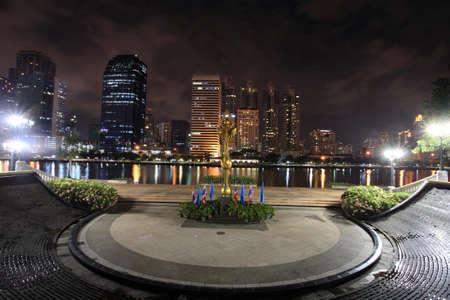 benjakitti: Golden lotus statue at Benjakitti park with modern buildings in Bangkok, Thailand