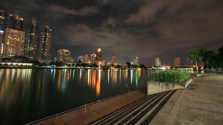 Bangkok downtown cityscape at night with skyline reflection at Benjakitti park in Bangkok,Thailand  Stock Photo - 16524605