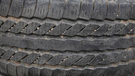 Old dark tire texture attached by pebble Stock Photo - 16674750