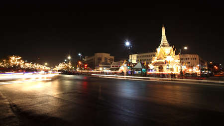 BANGKOK-DEC 04  Light trail on street in front of city pillar shrine at night in Bangkok, Thailand on December 04, 2012  city pillar shrine, called Lak Mueang, is built on 1782 on King Rama I reign  Stock Photo - 16782148