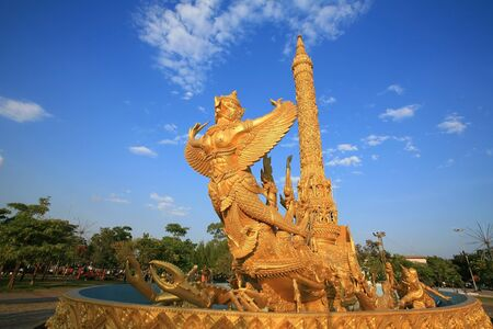 Gold garuda carving on the ship at Tung Sri Muang park in Ubon Ratchathani province, Thailand Stock Photo - 16784277