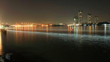 Light trail on Chao Phraya river at night near Rama III bridge in Bangkok, Thailand Stock Photo - 17087276