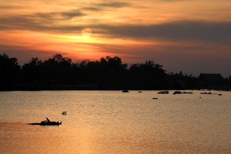 Rural sunset scene of the Bang Pakong river in Chachoengsao, Thailand Stock Photo - 17191266