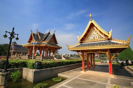 nonthaburi province: Two shrines decorated at Chalerm Prakiat park in Nonthaburi province, Thailand Stock Photo