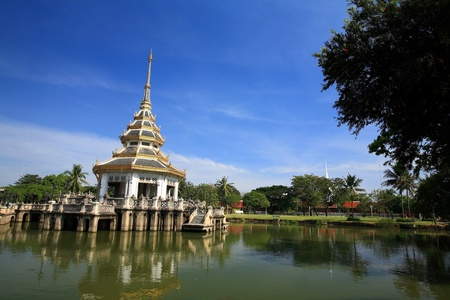 Beautiful pagoda on a lake against blue sky at Chalerm Prakiat park in Nonthaburi province, Thailand