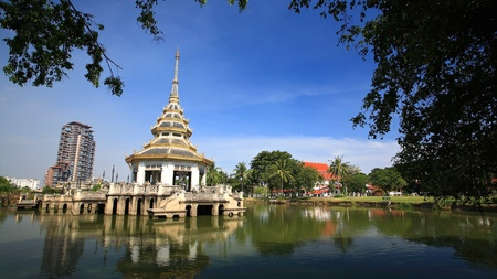 nonthaburi province: Beautiful pagoda on middle of a lake against blue sky at Chalerm Prakiat park in Nonthaburi province, Thailand