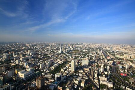 silom: Aerial view of Bangkok cityscape against blue sky