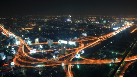 Aerial urban view of Bangkok expressway and city at night, Thailand  photo