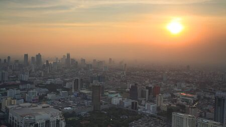 Aerial view of Bangkok Skyline cityscape during sunset in Thailand photo