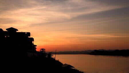 Village near Mekong River at dusk in Chiang Khan ,Thailand Stock Photo - 17398489