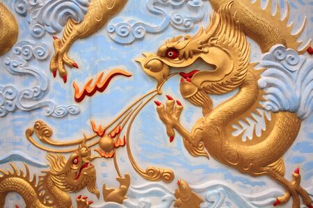 Gold dragon craft and painting on Thai temple wall Stock Photo - 17401799