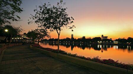 benjakitti: Cityscape during twilight with skyline reflection at Benjakitti park in Bangkok, Thailand