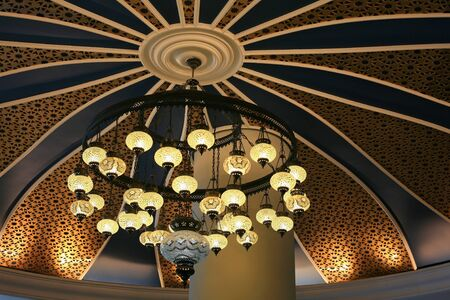 Luxury chandelier on colorful ceiling