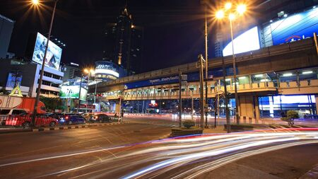 BANGKOK-JAN 18  Light trails on Asoke junction at night on January 18,2013 in Bangkok,Thailand  Asoke is the business area of offices and shopping malls that people can be here by skytrain and subway