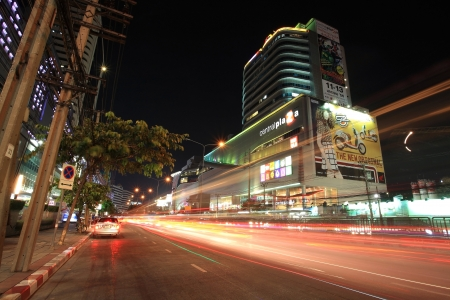 BANGKOK-JAN 18  Light trails on street and Central Rama 9, the famous shopping mall, located near Rama 9 junction on January 18,2013 in Bangkok,Thailand  Visitors can be here by MRT subway transit
