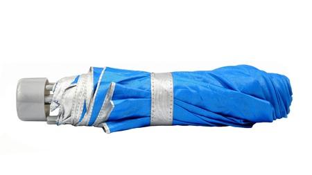 mini umbrella: Blue closed umbrella isolated on white background