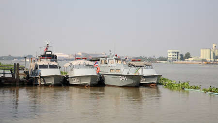 nonthaburi province: NONTHABURI-DEC 16  Small marine police ships parking on the port at Chao Phraya river on December 16, 2012 in Nonthaburi province, Thailand  Thai Marine police division is established in 1961