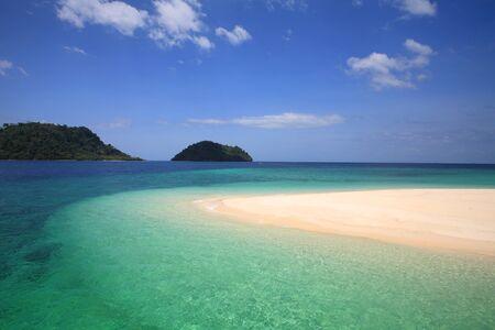 Beautiful Andaman crystal sea at shore on Khai island against blue sky in Satun province, Thailand Stock Photo - 18047564