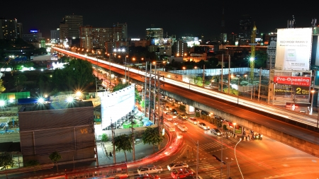 BANGKOK-JUL 06  Light trail on bridge at Rama 9 street on July 06, 2012 in Bangkok, Thailand  This bridge, located on Huay Kwang district, is set up to cross Rama IX junction and MCOT junction
