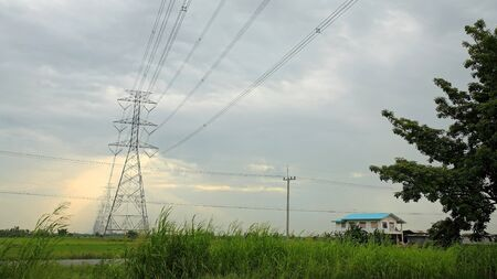 High voltage post or tower with ray light through the cloud photo