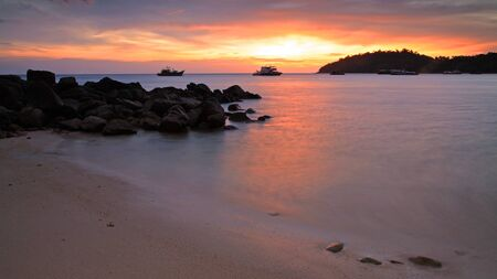 Colorful sunset over Andaman sea at twilight in Lipe island, Thailand photo