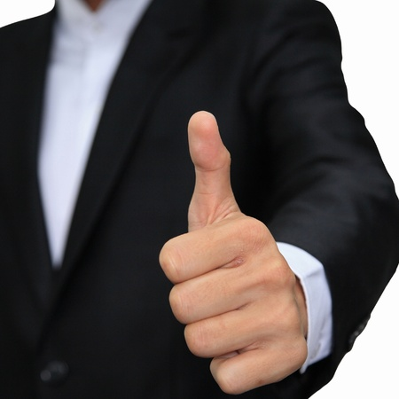 Business man hand with thumb up isolated on white photo