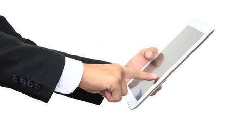 Business man finger pointing touch screen of digital tablet isolated on white photo