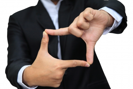 Business man thumb and forefinger connect for square shape